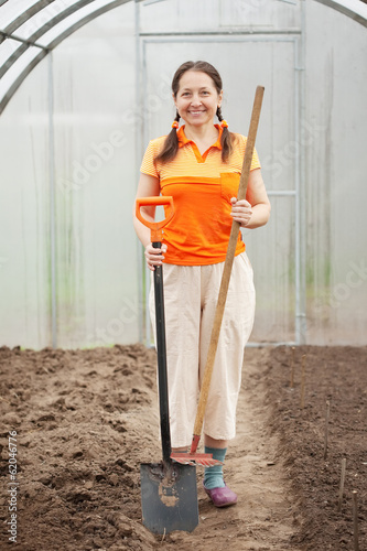 Happy mature  woman  with   tools
