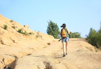 hiking woman walking on desert trail