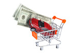 Toy car with money in shopping cart isolated on white