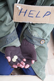 Beggar hands asking for a help