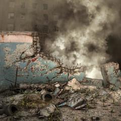 Ruiny muru i dym na tle miasta