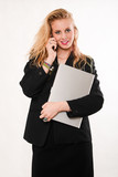 Attractive blond caucasian businesswoman carrying laptop