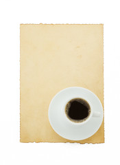 cup of coffee and parchment on white