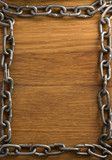 metal chain on wood