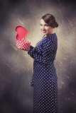 retro woman with heart-shaped gift box