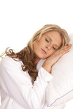 Woman white robe lay on pillow sleep