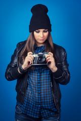 beautiful young woman holding camera