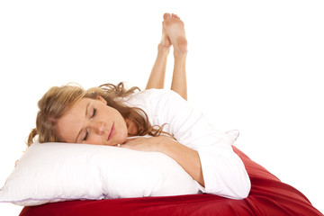Woman white robe red sheet lay sleep