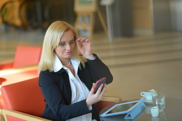 Candid photo of a atractive middle-aged blond businesswoman