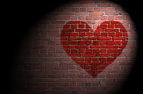 Red heart on brick wall