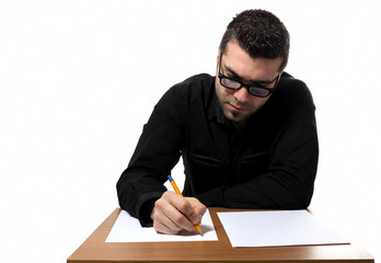 Young man filling forms and papers like taking an exam.