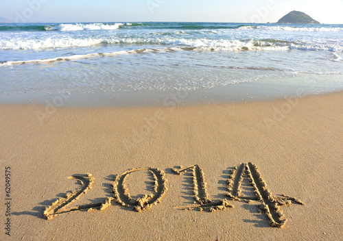 2014 word drawn on beach