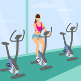 Young woman uses a bicycle in the gym for a good mood