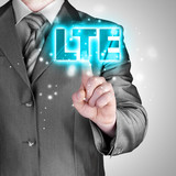 businessman is pushing his finger on lte button