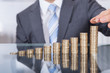 canvas print picture - Businessperson With Stack Of Coins
