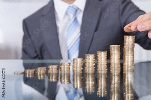 canvas print picture Businessperson With Stack Of Coins