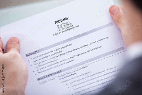 Businessperson Holding Resume