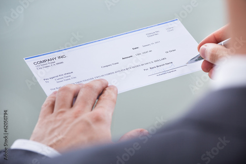 Businessperson Signing Money Cheque
