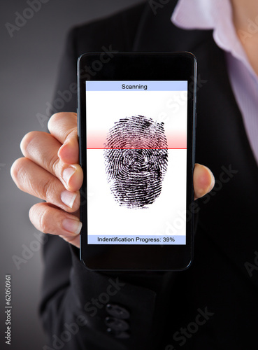 Businessperson With Cellphone Scanning A Fingerprint