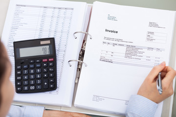 Businessperson With Document And Calculator