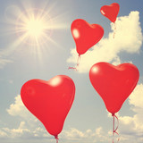 Love balloons on blue sky.