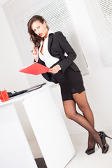 Sexy business woman standing in the office