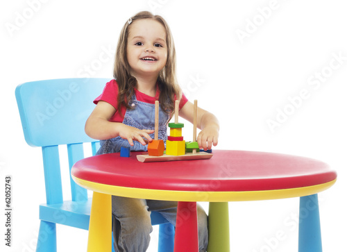 Child sitting at the table and playing