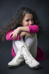 pretty little girl sitting on the floor in white boots
