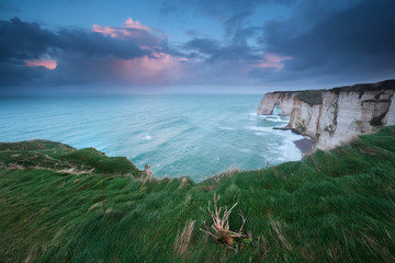 stormy sunrise over cliffs in Atlantic ocean