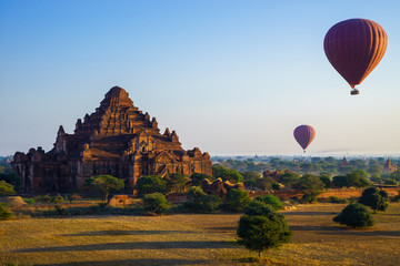 Balloon over Dhammayangyi temple at sunrise,  Bagan, Myanmar