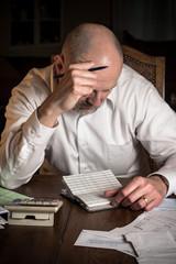 Man  concentrating over finances