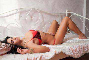 Beautiful slender girl in red lingerie