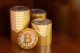 Golden Bitcoins on a wooden board