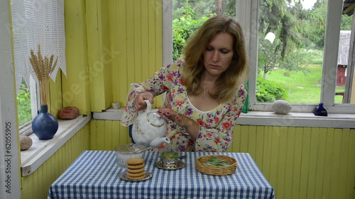 girl rural kitchen prepared soothing  tea of fresh lemon balm