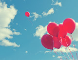 Bunch of red ballons on a blue sky - 62056323