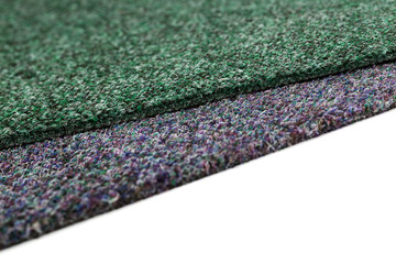 A close up picture of a gray and green carpet