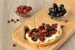 Toast with olives, sun-dried tomatoes and cottage cheese