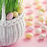 Small easter eggs in a white basket