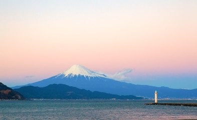 Mount Fuji and a light house seen from the beach