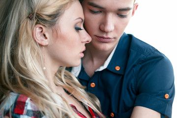 Portrait of young sensual couple. love and kiss