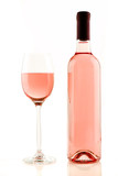 Bottle and glass of rose wine isolated