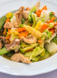 Stir fried mixed vegetables with pork on white plates