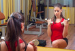 Beautiful girl exercising with dumbbells.