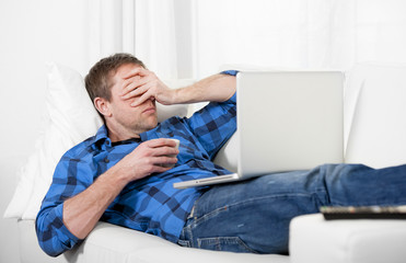 Young attractive man with headache and stress using Computer