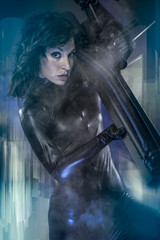 Conflict, armed woman in a garage, future concept, black latex w
