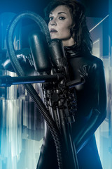 Space, armed woman in a garage, future concept, black latex with