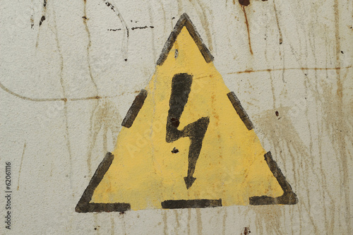 high voltage sign on a gray wall