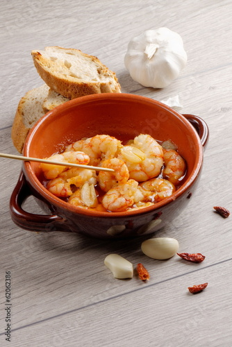 Spanish tapas dish, sizzling prawns with chili and garlic