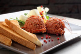 Tasty beef tartare with toast bread and butter