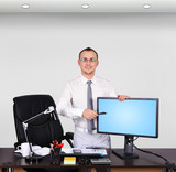 businessman pointing to monitor